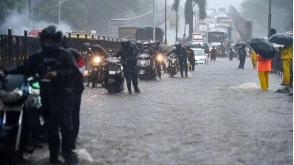 Monsoon arrives in Mumbai, local train services suspended due to heavy rains