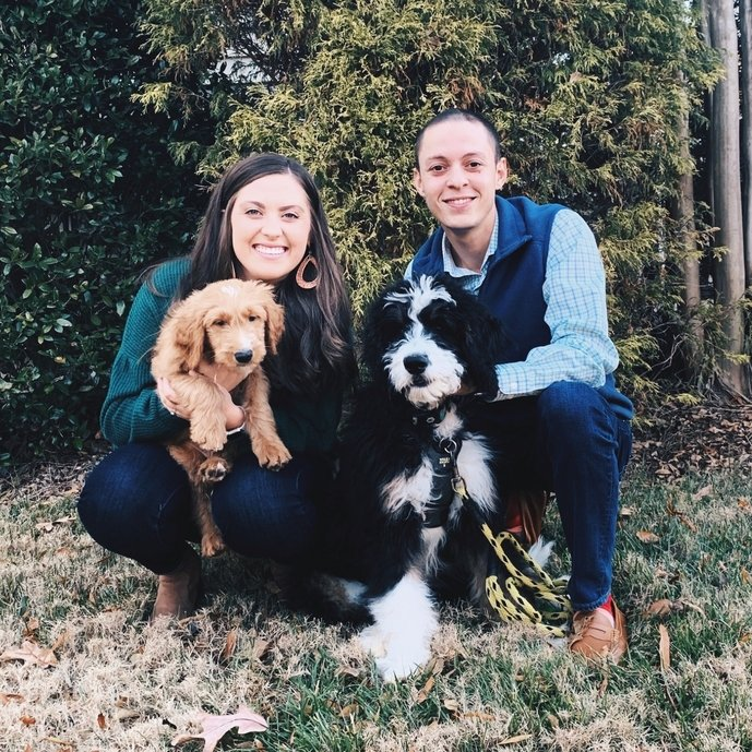 two people with dogs