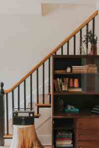 bookcase and stairs in renovated home