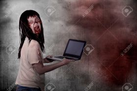 Creepy female zombie typing with laptop over grunge background