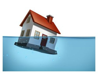 house floating half in and half out of water
