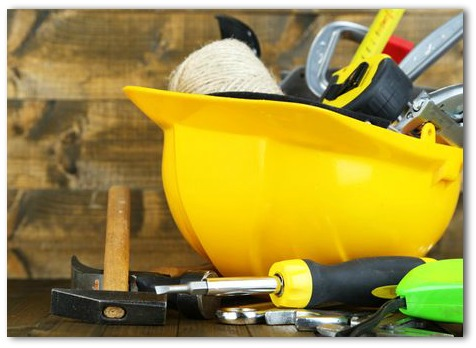 photo of construction helmet and tools