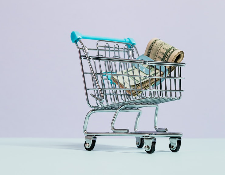 Photo of grocery cart with money inside