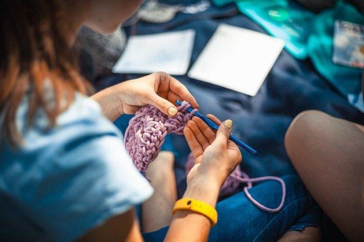 photo of girl knitting