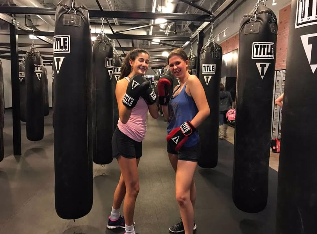 Elizabeth and Mary kickboxing.