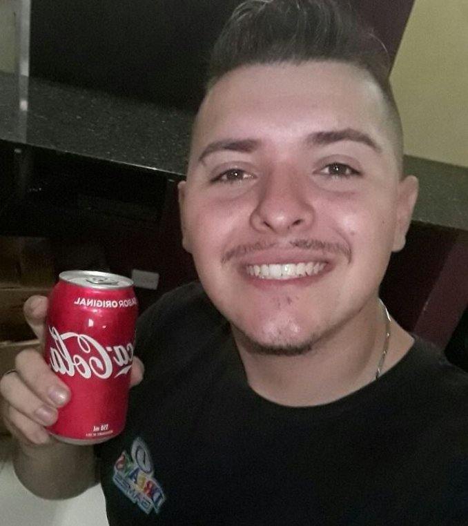 "Allan Guilherme Weber buys a can of Coke almost every day. ""Diet Coke and water just don't do it for me"", he stated. Photo credit Jackie Costa Ribeiro"