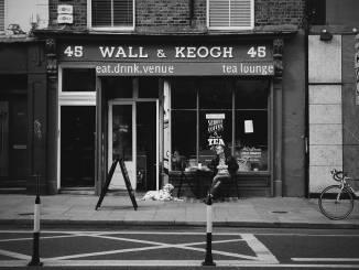 Man and Dog Sitting outside Wall & Keogh