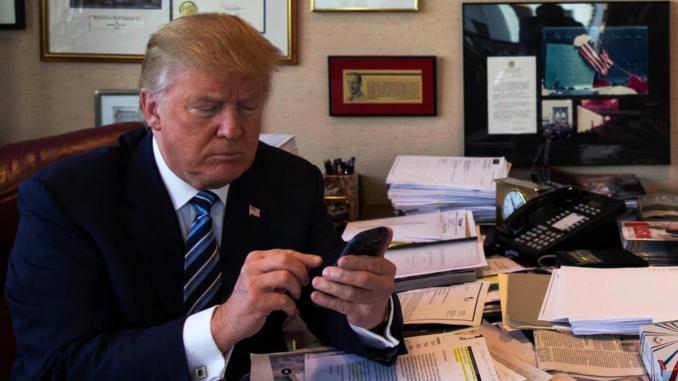 Donald Trump on his phone