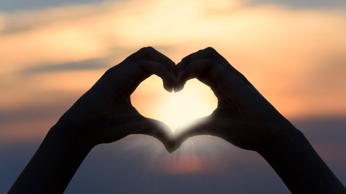 Two hands joining - love heart