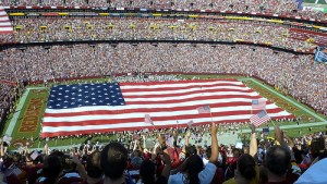 An American flag sprawled across the pitch at FedEx Field before a Redskins home game. Image by Jeremy Thoel on flickr