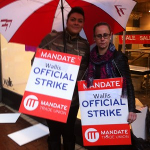 Melanie Rooney and her collegue picketing outside Wallis in the rain on Grafton St yesterday.