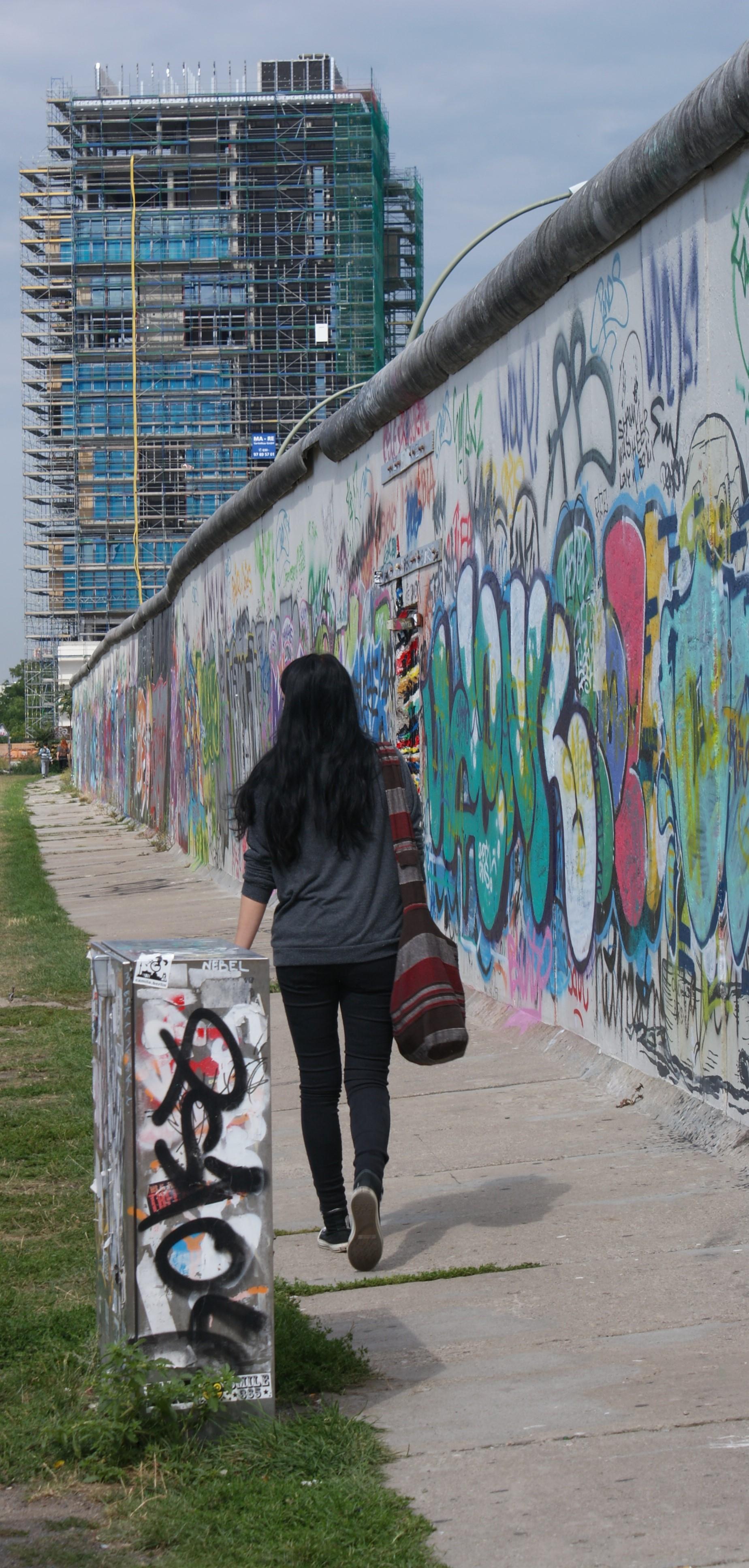 Woman walks along section of Wall