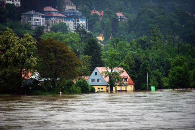 Houses flooded by the Elbe, Dresden, Germany (Photo: NYT|Arno Burgi/DPA, via Agence France-Presse — Getty Images)
