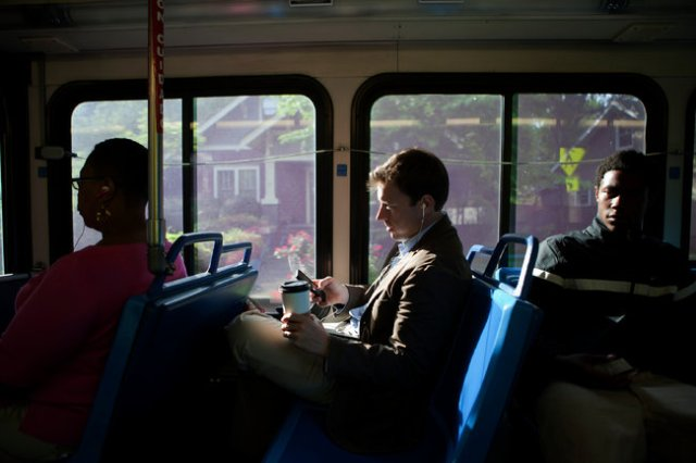 Meanwhile, young Americans are beginning to find smart phones more interesting than cars. (Photo: NYT)