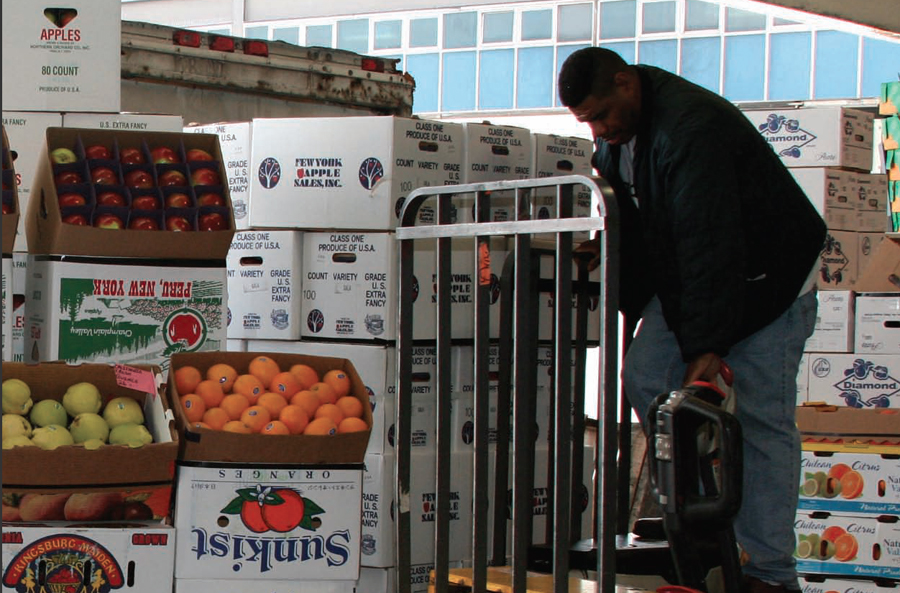 Worker loading apples at the Hunts Point Food Distribution Center (Photo: NYC SIRR)