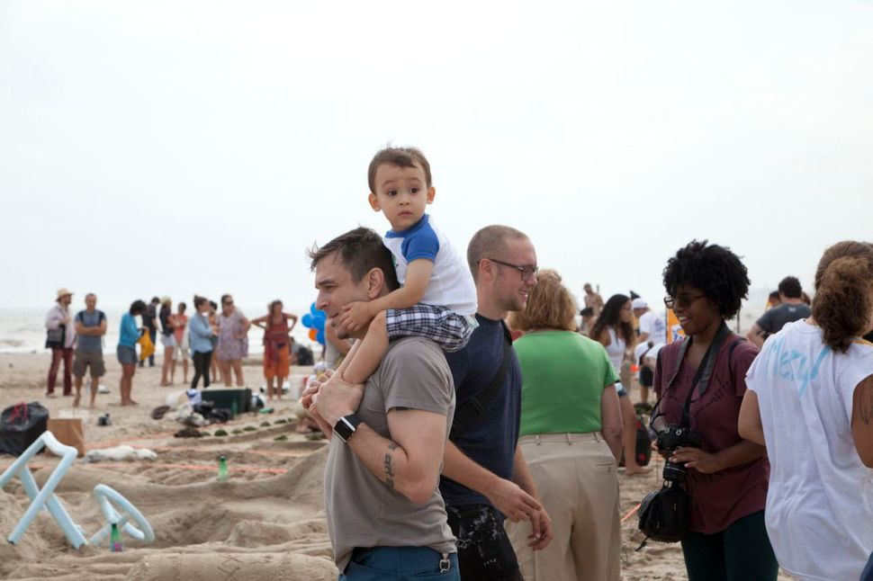 Visitors to a sandcastle competition on Rockaway Beach, summer 2013. (Photo: Jessica Bruah)