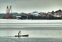 A fisherman navigates the waters near Tumaco, Colombia.