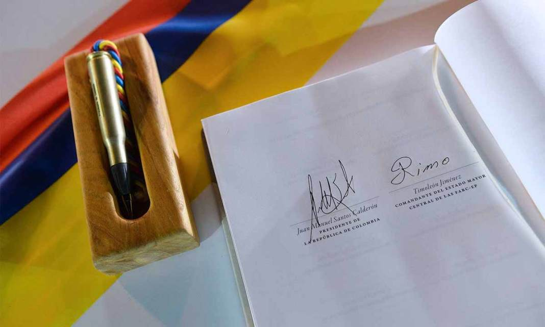 Colombia's signed peace agreement rests next to the bullet pen used to sign it. (Photo courtesy Presidencia de la Republica)