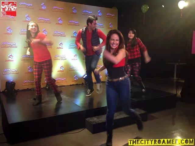 Regine Tolentino and Lander Vera-Perez with their kids at the Jollibee Christmas Party doing the Zumba Dance