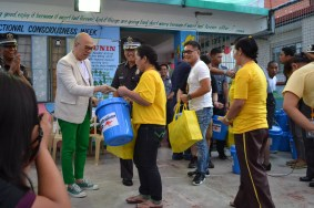 MYNP Founder and Chairman Boy Abunda handing out food and hygiene packs, assisted by President Mike Sicat and BJMP Officials