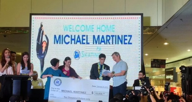 Michael Martinez awarded check