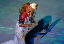 Russian Tennis Player Maria Sharapova Holding the Olympic torch during the Opening Ceremony of the Sochi 2014 Winter Olympics
