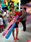 Blogger Marjorie Pineda-Uy with her winnings at Sky Ranch Pampanga Game Booth
