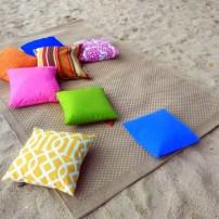 Beach mat and pillows at the sands of Aquaria Beach Resort