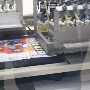 CustomThread's Kornit Digital printer working a black shirt