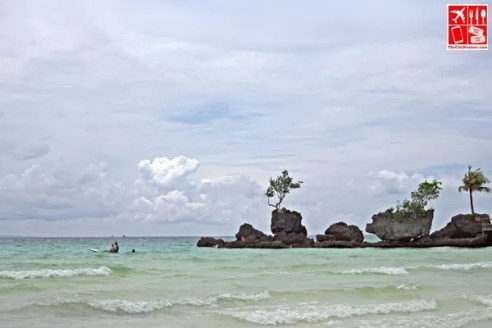 From afar, the volcanic grotto known as Willy's Rock, at White Beach in Boracay.