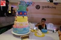 A Goldilocks cake decorator working on his masterpiece