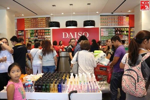 Shoppers line up at the counter to pay at Daiso Japan UP Town Center