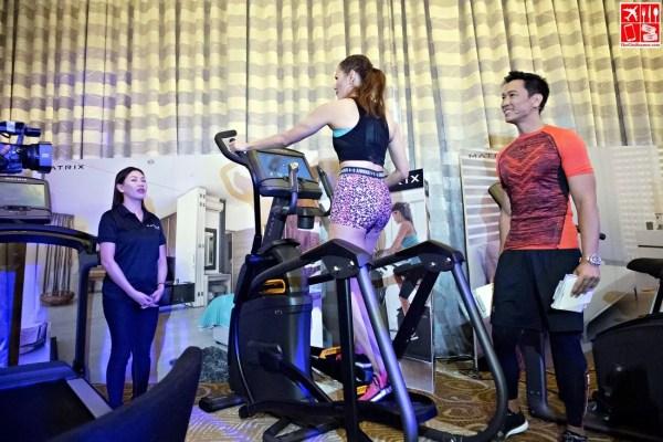 Coach Jim and Toni Saret demos Matrix Cardio Fitness Equipment