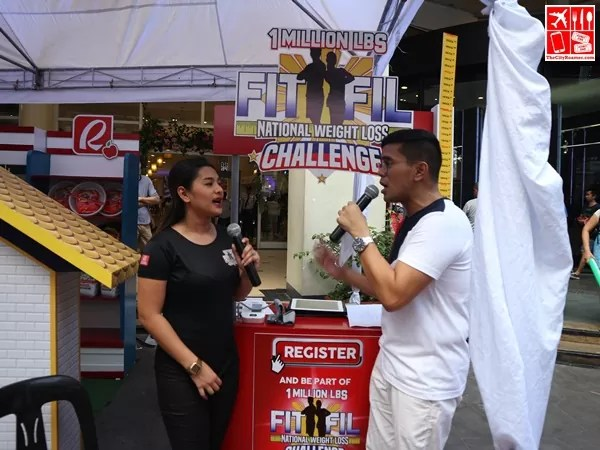 Tonipet Gaba visits the FitFil booth at the Robinsons Supermarket Celebrate Wellness event