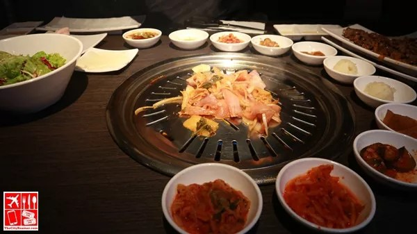 Meat and side dishes grilled together