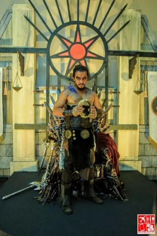 A cosplayer poses at the GOT Iron throne