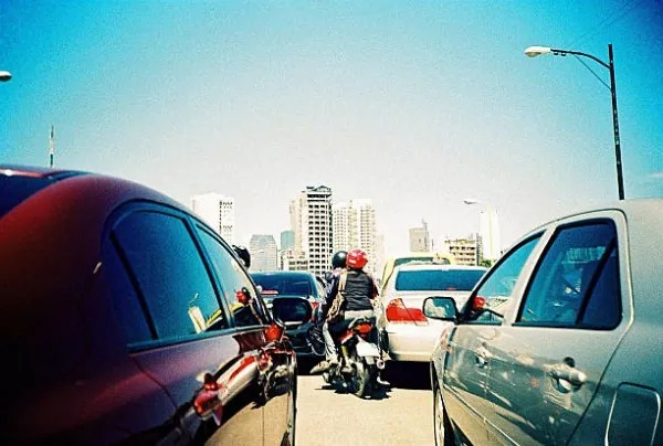motorcycle squeezing in traffic