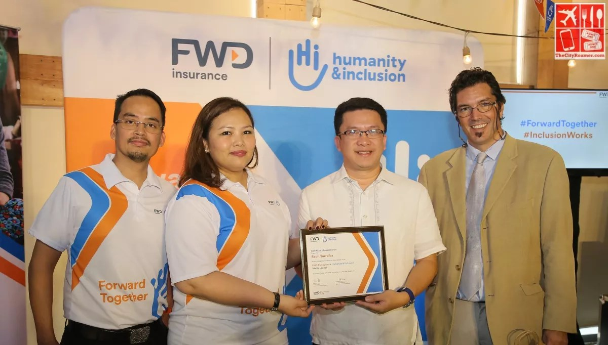 Guest of honor Raphael Torralba (third from left), DFA Assistant for Programs for PWDs receives a plaque of appreciation