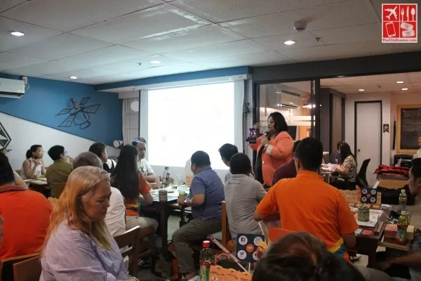 FWD Insurance HR Manager for People and Culture Ana Katrina Guarin (background, peach blazer) gives players the overview of game mechanics as Praxis Game Master and discusses FWD Set for Tomorrow plans