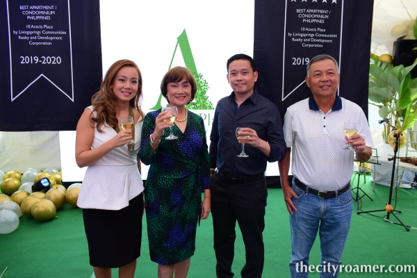 Livingsprings Executive doing a toast in celebration of the award received for the condominium development