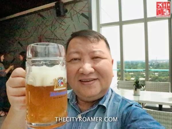 Enjoying a mug of Weihenstephan beer