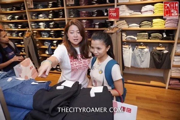 A girl is being assisted to shop