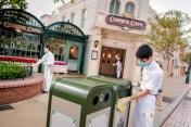 Hongkong Disneyland cast members clean the park