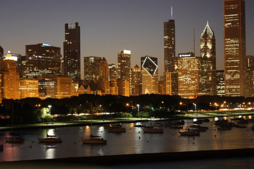 A nighttime view of the Chicago skyline from the Chicago River
