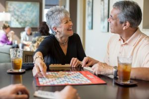 The Clare residents play a game of scrabble.