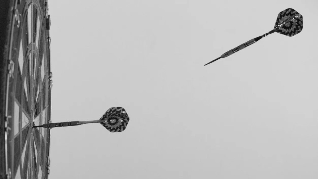 decorative images of darts hitting target