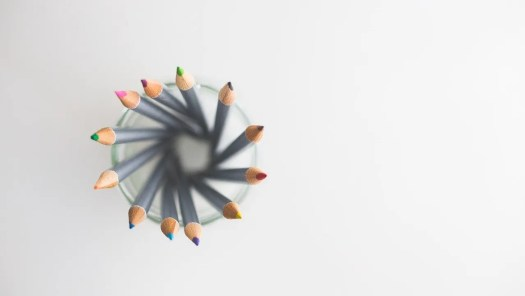 Decorative image of coloring pencils arranged in a ring.