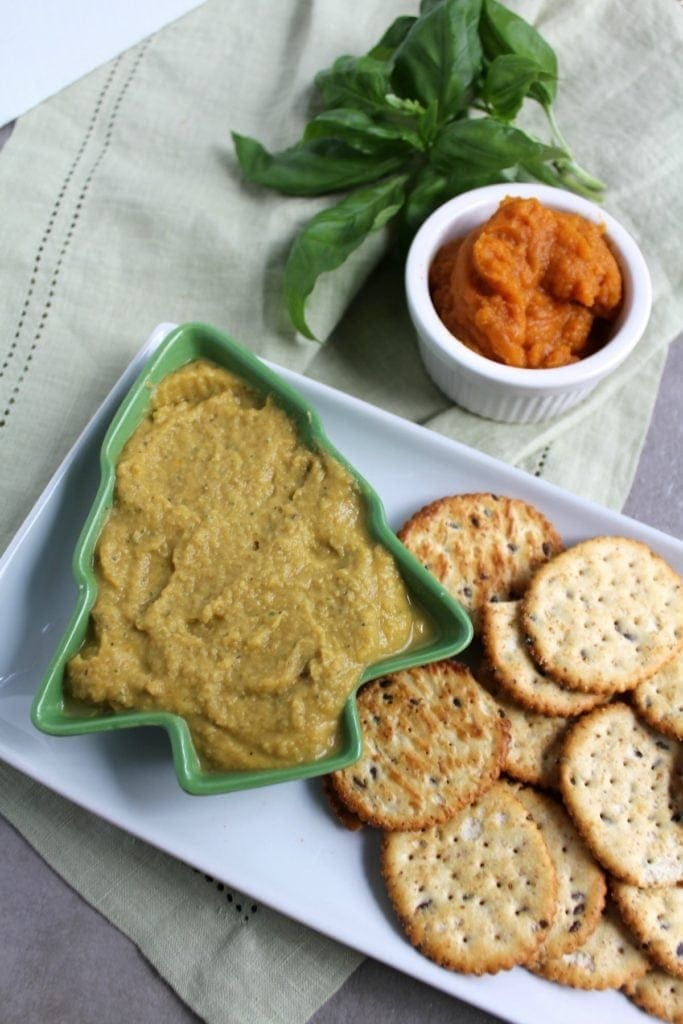 Healthy Pumpkin Basil Hummus is the easiest snack! Packed with protein and delicious fresh herbs - it's perfect for holiday parties or an afternoon snack, especially when paired with Back to Nature Crackers!