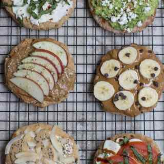 6 Healthy Breakfast Toast Combos on a black wire cookie sheet.