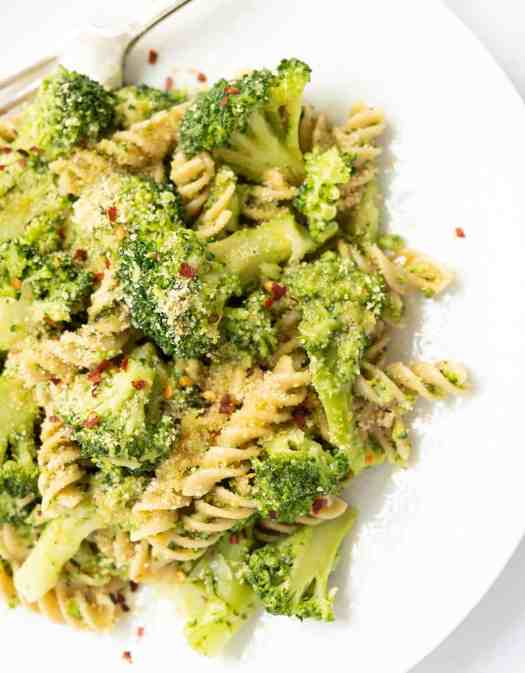 Vegan broccoli pasta with chili flakes and breadcrumbs on a white plate - The Clever Meal